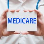 MD holding medicare sign