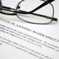 Estate planning worksheet with glasses on top of document
