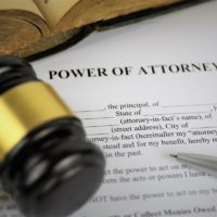 power of attorney document with gavel, pen and book