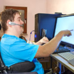 Disabled boy on computer