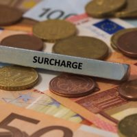 Sign that reads Surcharge.jpg.crdownload