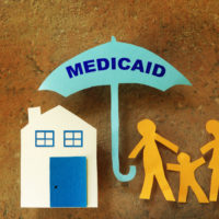 Umbrella that reads Medicaid'