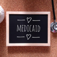 Chalkboard that reads medicaid