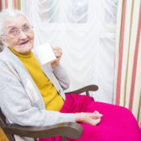 Elderly woman sitting down