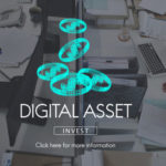 Coins and a digital asset sign